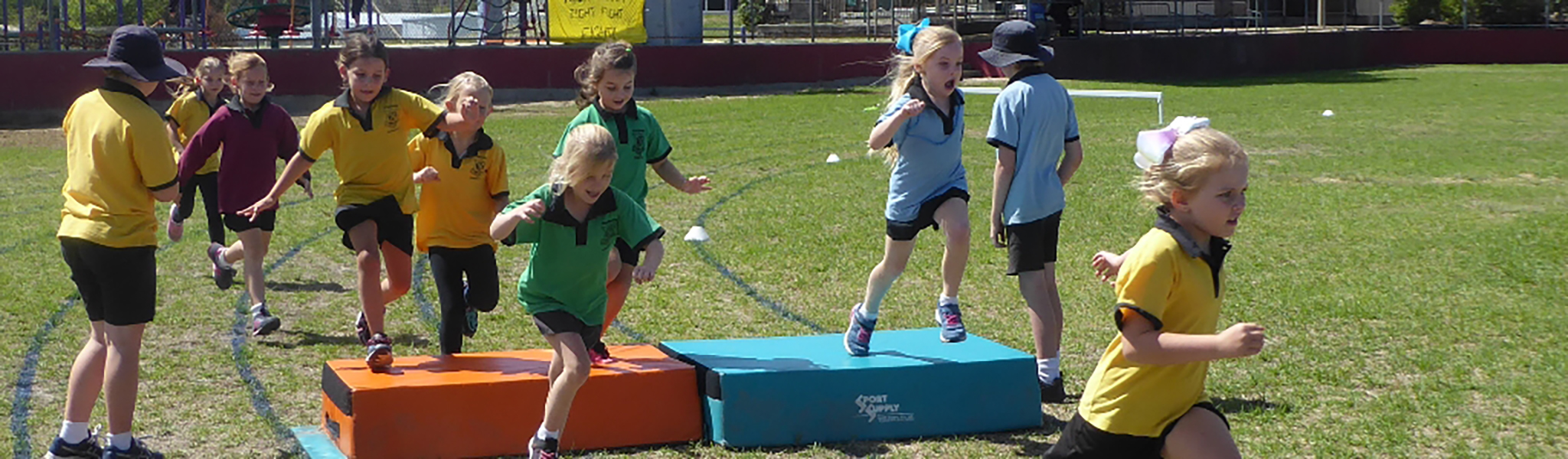 Students in sports day hurdles